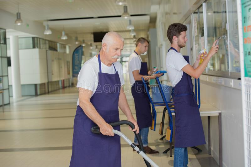 Positive professional cleaners team. Team royalty free stock photography