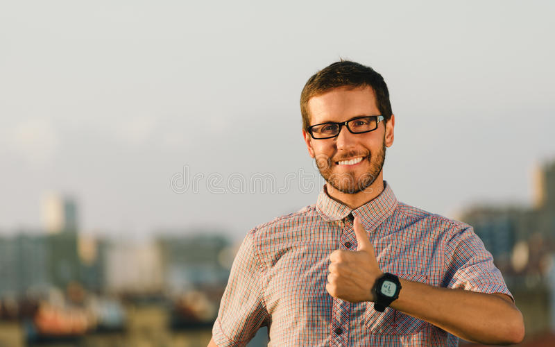 Positive professional man doing thumbs up gesture royalty free stock photo