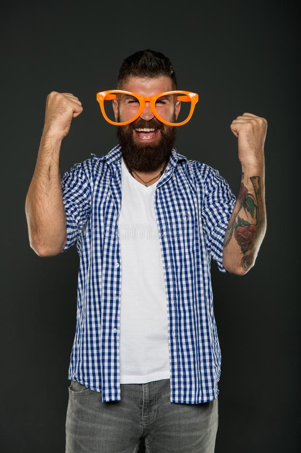 Positive psychology. Overcome life troubles with smile. Happiness and positive. Stay positive. Man brutal bearded. Hipster wear funny eyeglasses accessory royalty free stock images