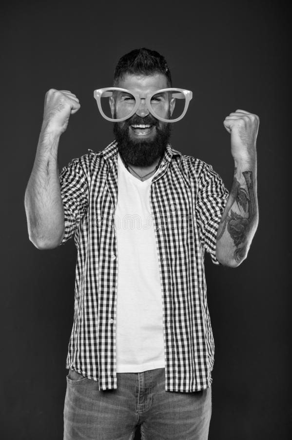 Positive psychology. Overcome life troubles with smile. Happiness and positive. Stay positive. Man brutal bearded. Hipster wear funny eyeglasses accessory royalty free stock photos