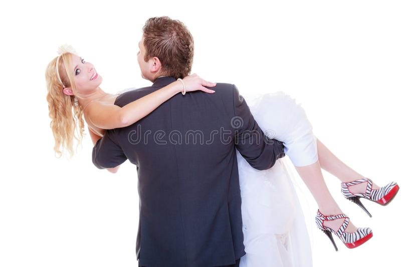 Groom carry bride in his arms. Positive relationship couples concept. Happy groom and bride posing for marriage photo waiting for the big day, he carry women in royalty free stock image