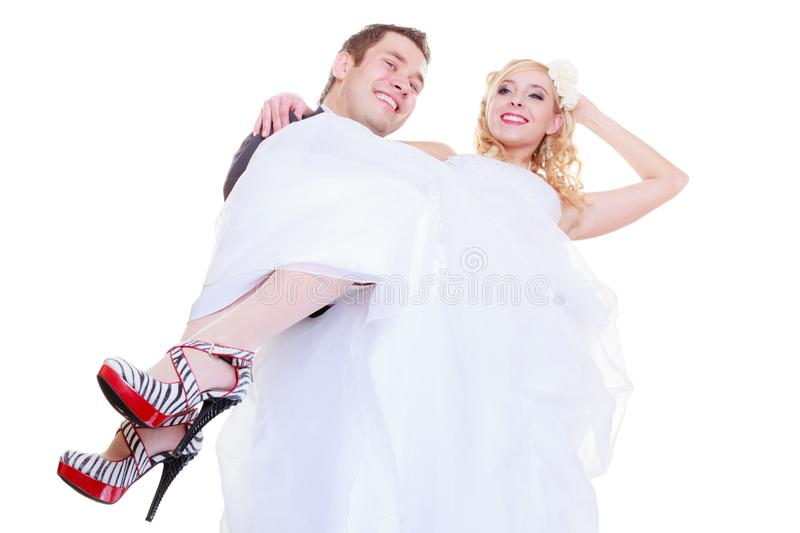 Groom carry bride in his arms. Positive relationship couples concept. Happy groom and bride posing for marriage photo waiting for the big day, he carry women in stock photography