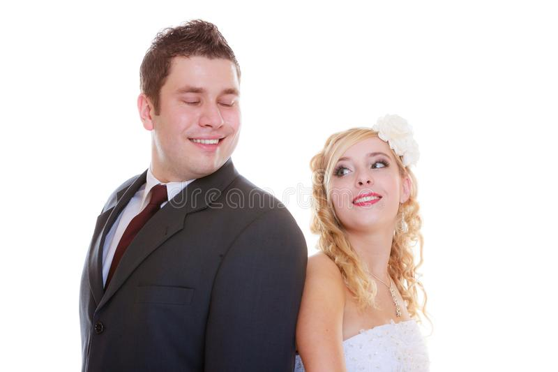 Happy groom and bride posing for marriage photo. Positive relationship couples concept. Happy groom and bride posing for marriage photo waiting for the big day royalty free stock image