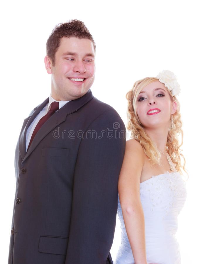 Happy groom and bride posing for marriage photo royalty free stock image