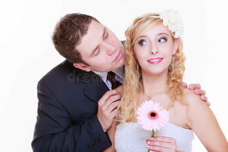 Happy groom and bride posing for marriage photo. Positive relationship couples concept. Happy groom and bride posing for marriage photo waiting for the big day stock photography