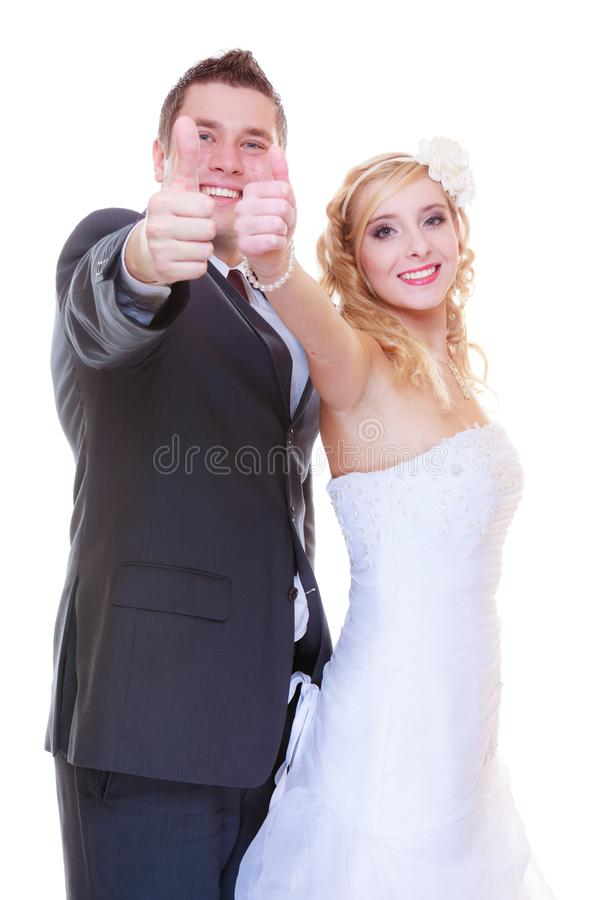 Happy groom and bride posing for marriage photo stock photos