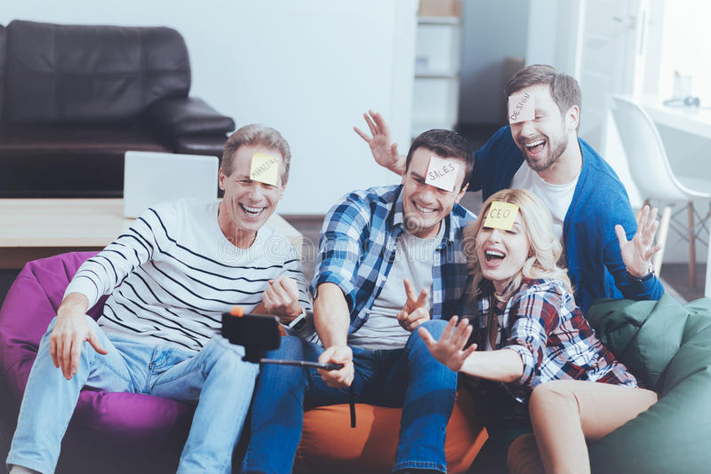 Positive relaxed colleagues making selfies royalty free stock photos