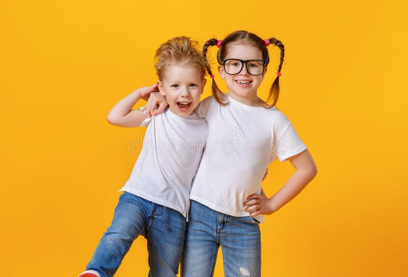 Positive siblings in similar clothes royalty free stock photography