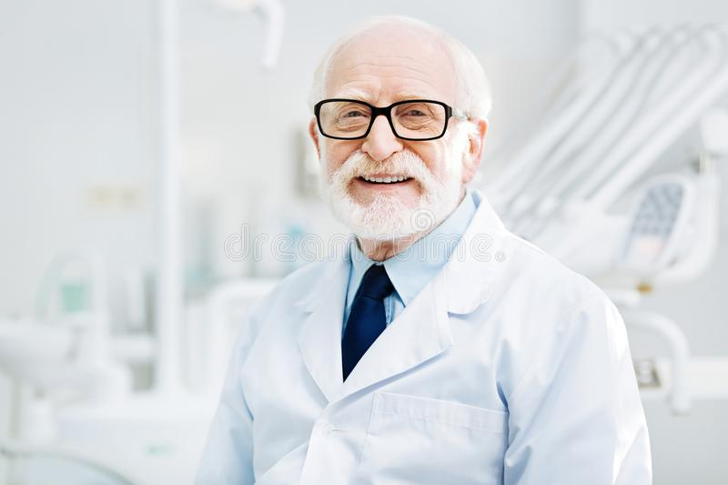 Positive smile of experienced doctor stock photos