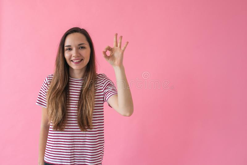 The girl shows the sign Ok stock photos
