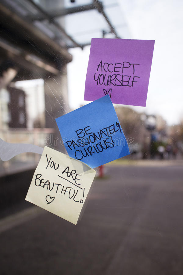 Positive Sticky Notes Posted On Bus Shelter Royalty Free Stock Photography