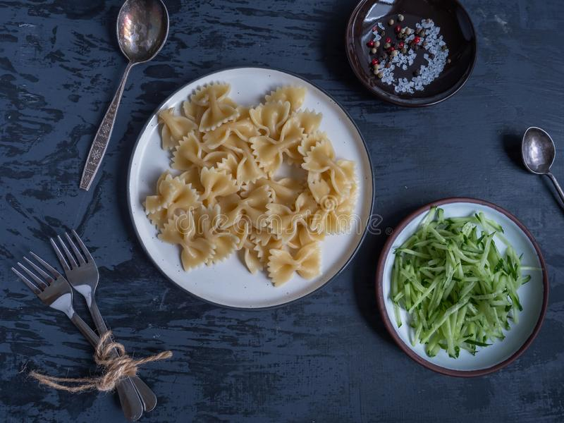 Positive still life with pasta, scrambled eggs and cucumber and radish salad. Tasty healthy food from natural products royalty free stock photos