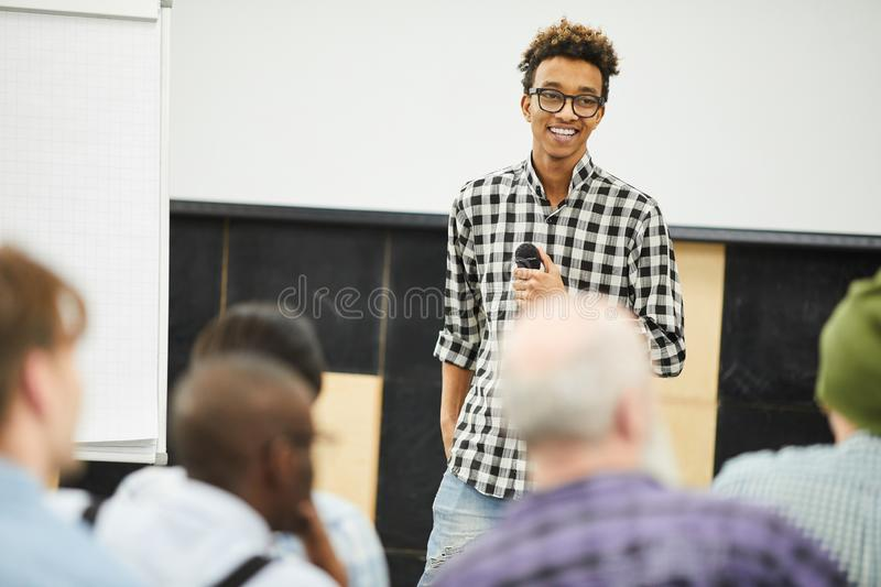 Positive successful young entrepreneur at business conference stock images