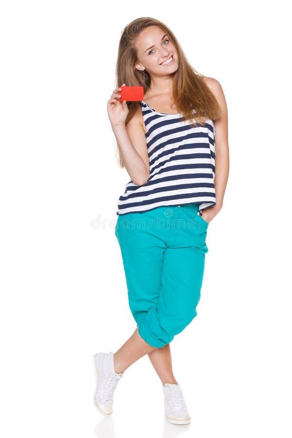 Positive teen girl smiling showing credit card stock photos