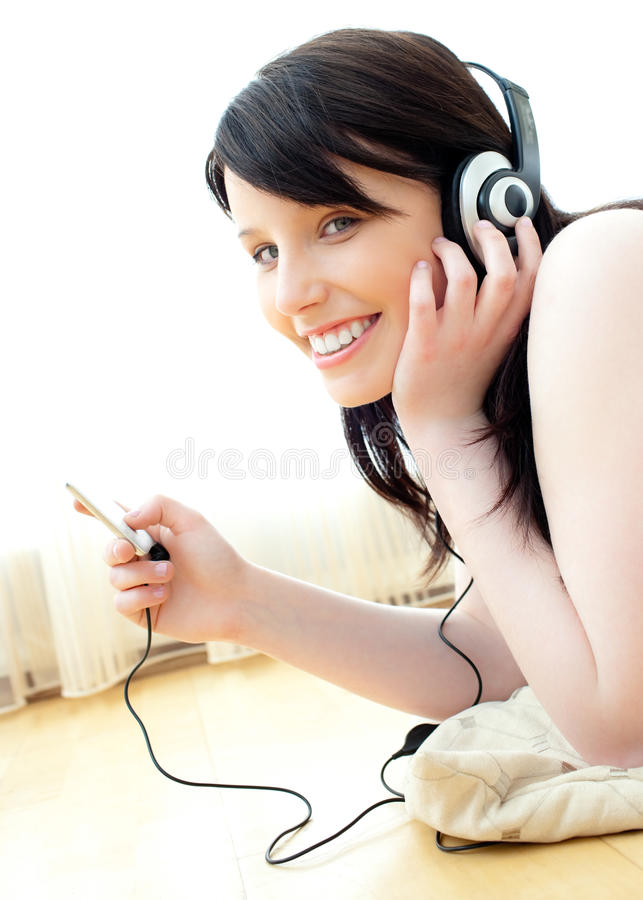 Download Positive Teenager Listening To Music On The Floor Stock Photo - Image: 15339088