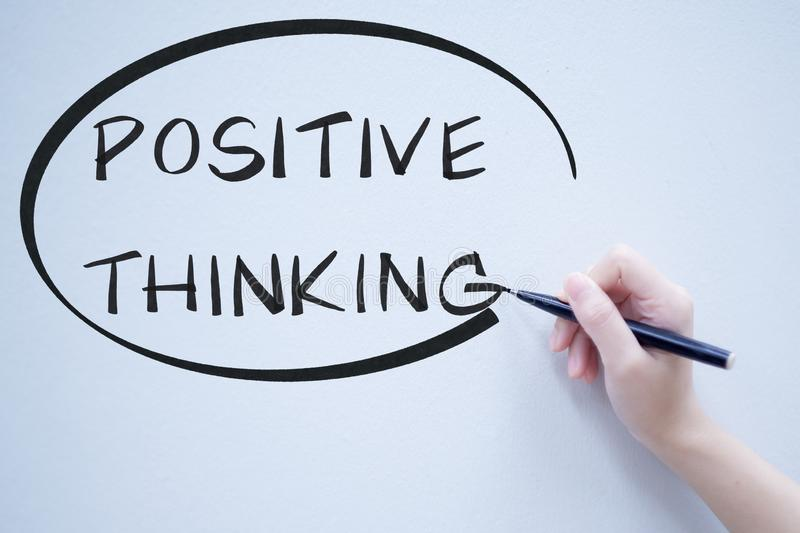 Positive thinking text handwriting on whiteboard stock images