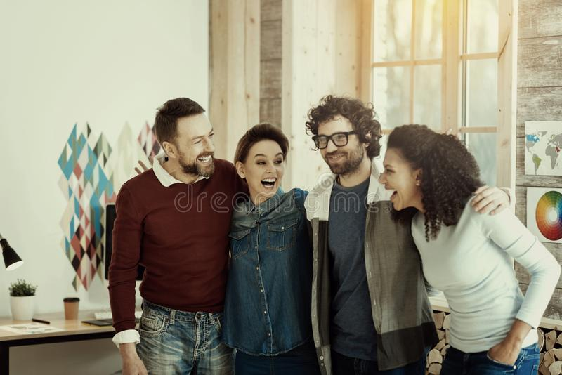 Positive trade marketing team having a good time together royalty free stock photography