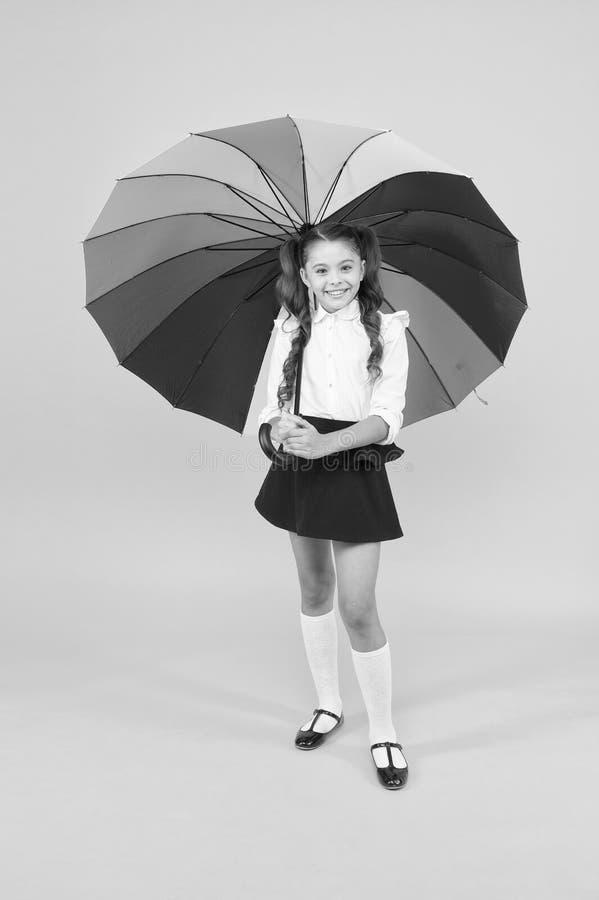 Positive vibes. Everything under control. Fancy schoolgirl. Girl with umbrella. Rainy day. Happy childhood. Rainbow. Umbrella. Kid happy with umbrella. Fall stock photo