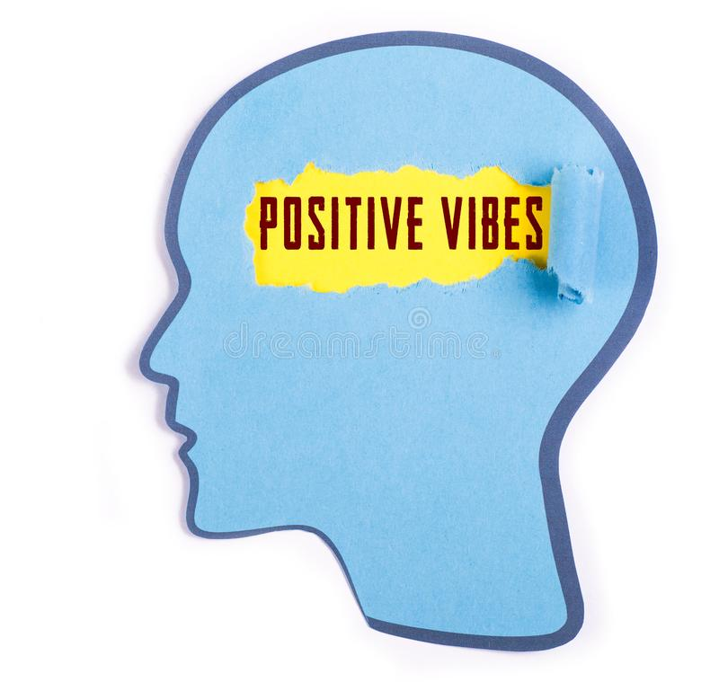 Positive vibes text in the person head. Torn blue paper and Paper head concept Thoughts inside the brain royalty free stock photography