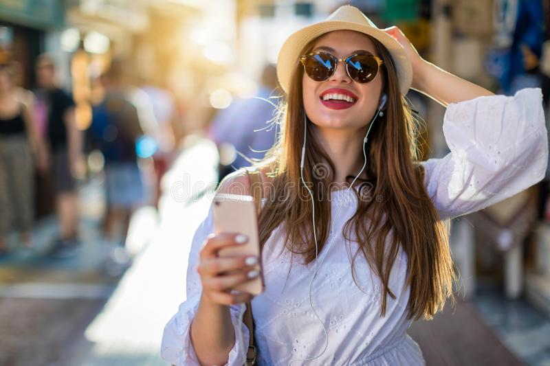 Positive vibes urban woman in the city royalty free stock photography