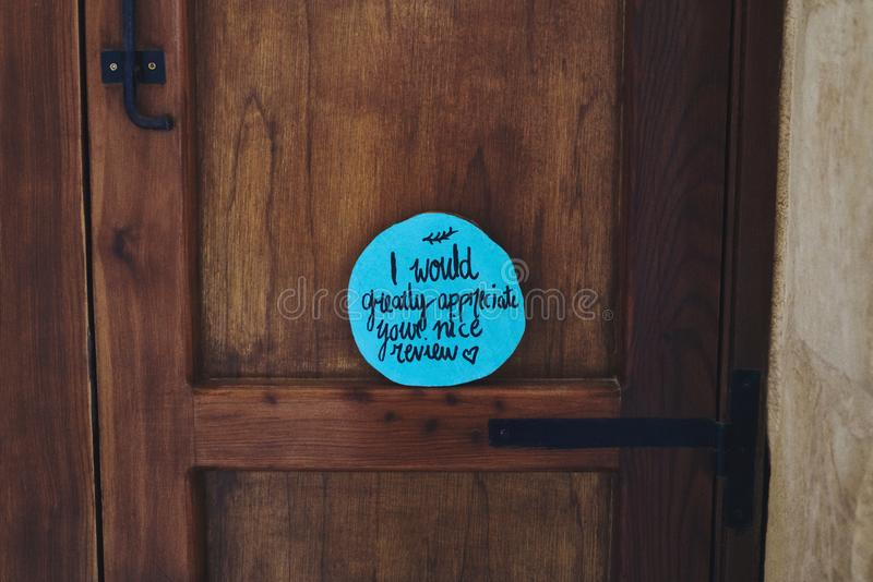 Positive wish on the door stock photography
