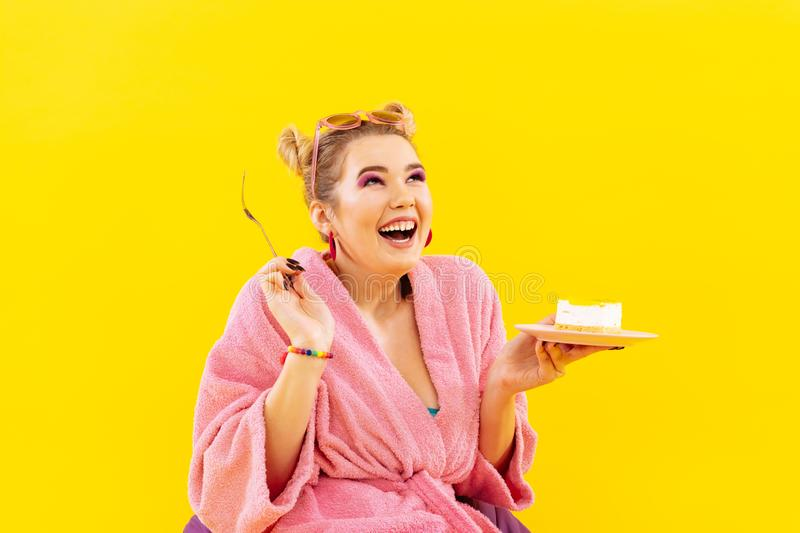 Positive woman loving sweets feeling excited before eating cake royalty free stock images