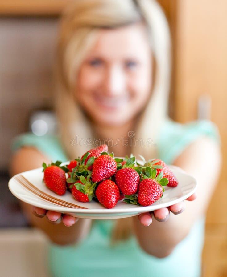 Positive woman showing fruits stock photos