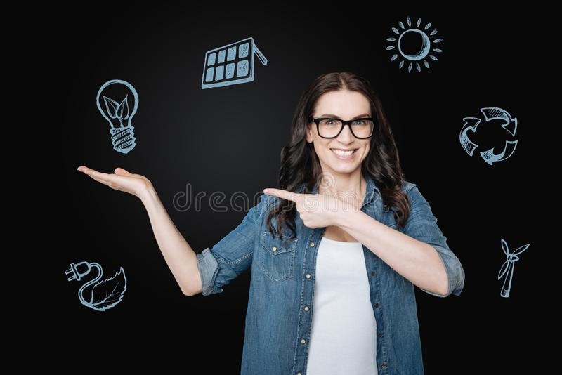 Positive woman smiling and talking about her ecofriendly lifestyle stock photos