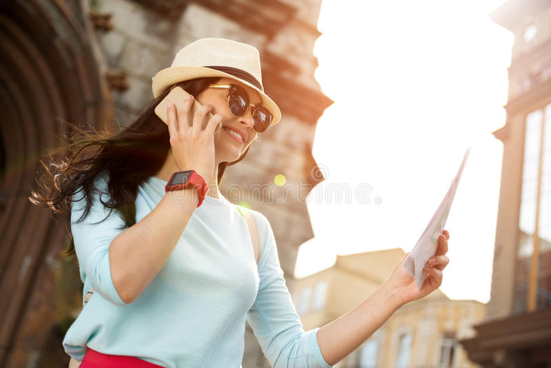 Positive woman talking on cell phone stock photography