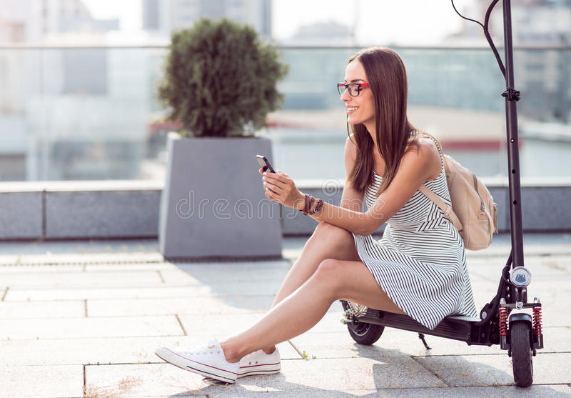 Positive woman using cell phone stock photos