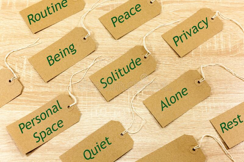 Positive words associated with solitude. Written on cardboard labels stock photos