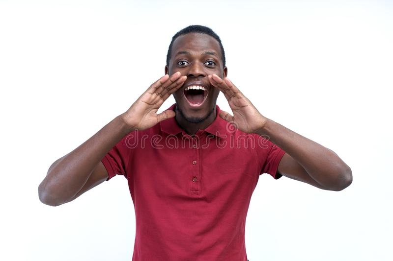 Positive young black guy, student, worker employee screams mouth stock photography