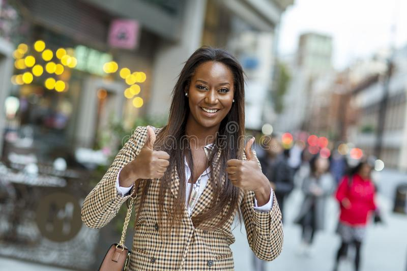 Positive young woman in the city stock photo