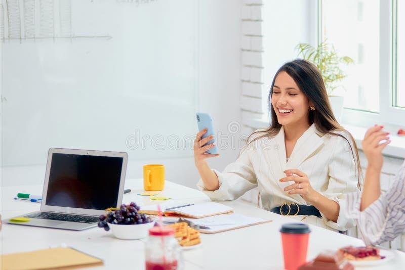 Happy joyful caucasian woman laughing at funny joke talking on smartphone royalty free stock images