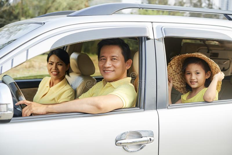 Cheerful family riding in car stock photography