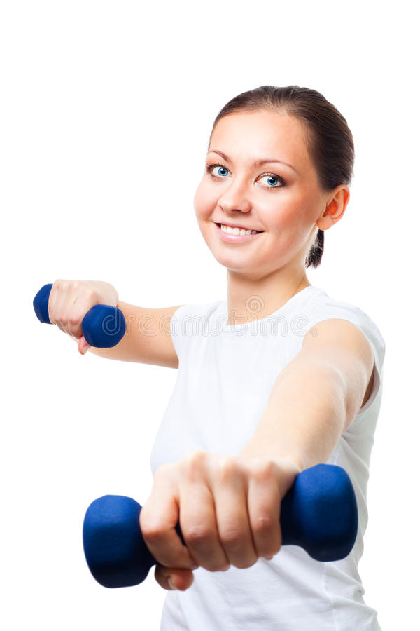 Positive young woman with dumbbells