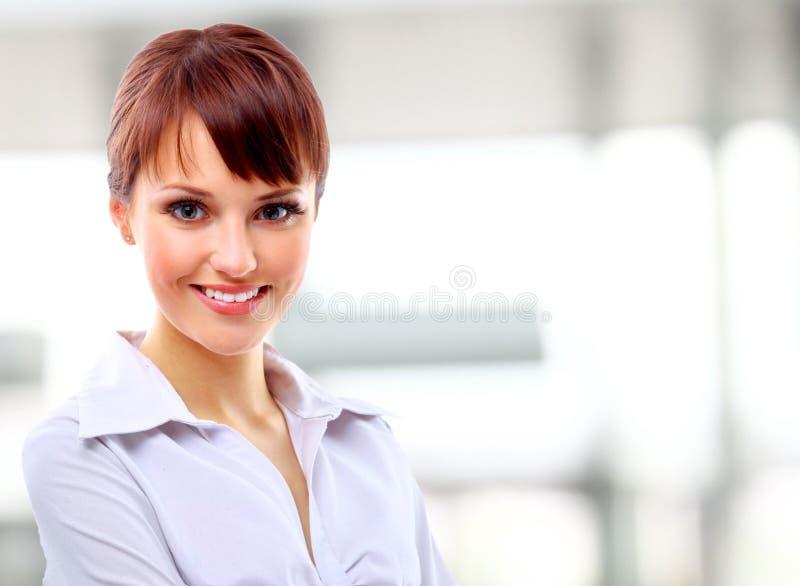Positives Geschäftsfraulächeln lizenzfreie stockfotos