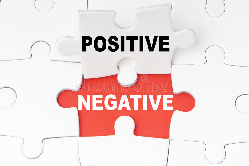 Positives and Negatives. On puzzle stock photo