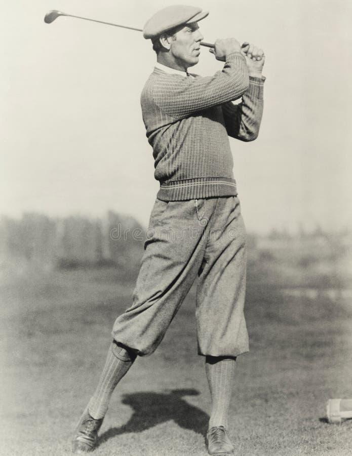 Posizione dei giocatori di golf immagini stock