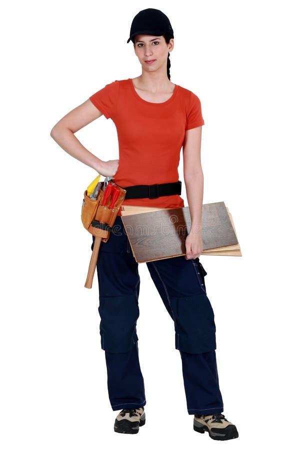Posizione femminile del carpentiere fotografia stock libera da diritti