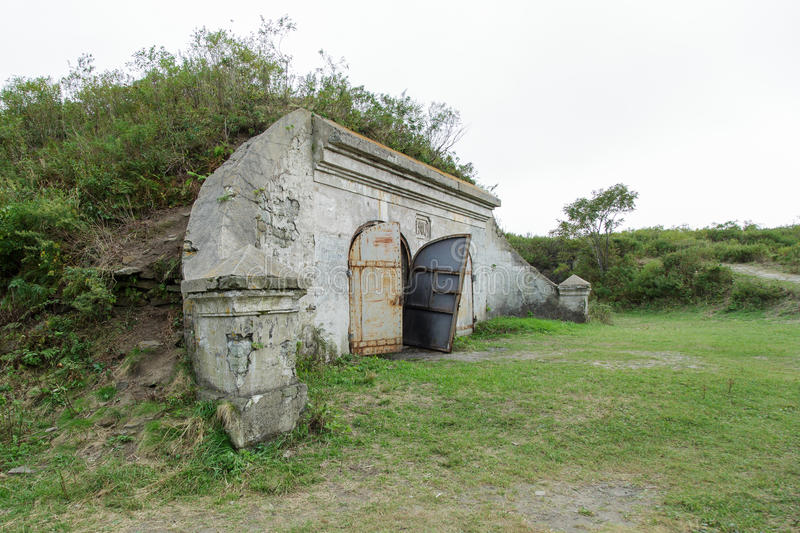Pospelovs fort a wall of the old bunker with old doors. Vladivostok, Russia - October 1th, 2016: Vladivostok, the Fortress Pospelovs Fort, a wall of the old stock image
