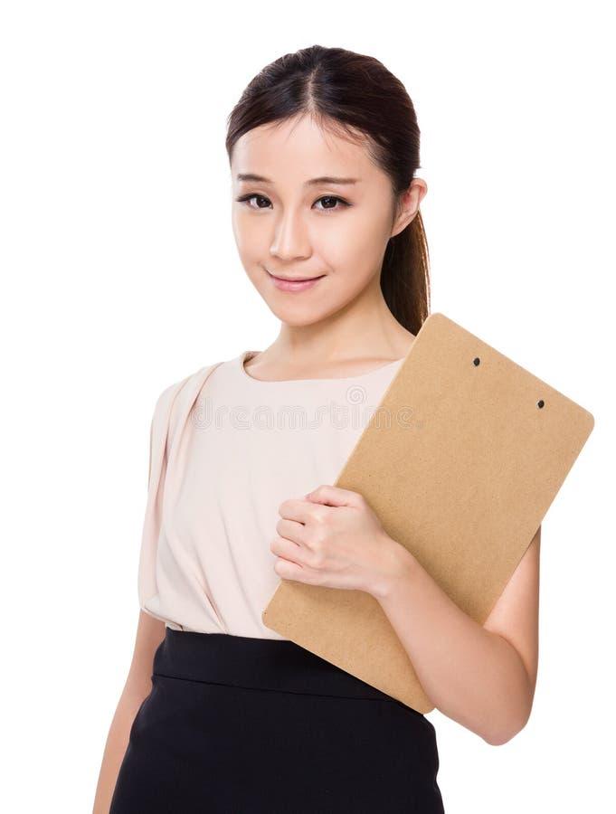 Posse asiática da mulher com prancheta fotografia de stock
