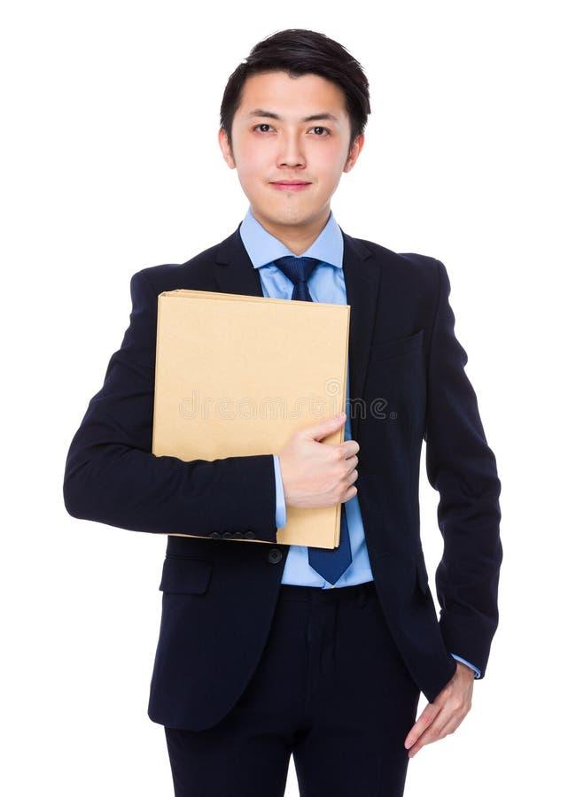 Posse asiática do homem de negócios com dobrador fotografia de stock