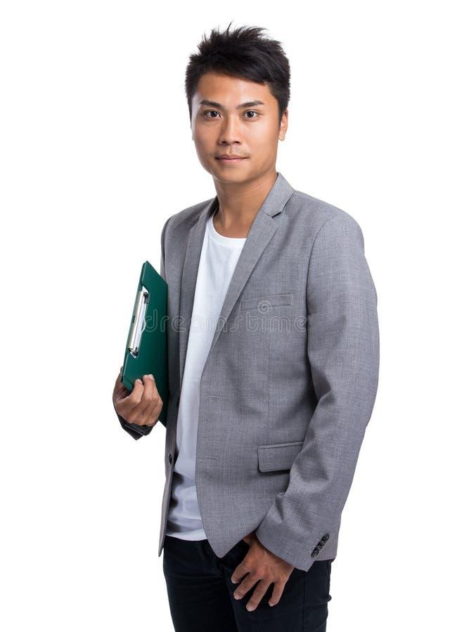 Posse asiática do homem de negócios com placa do arquivo fotografia de stock