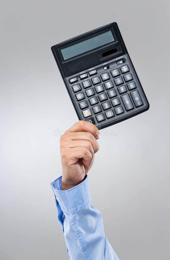 Posse do homem de negócios com calculadora fotos de stock