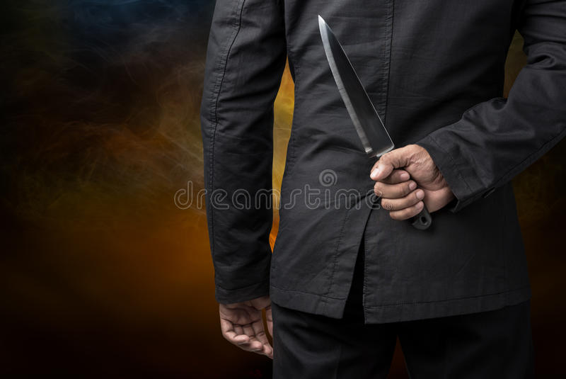 Posse do homem de negócios na faca imagem de stock