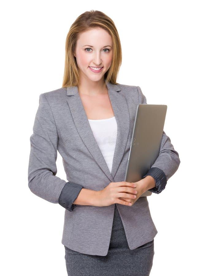 Posse nova da mulher de negócios com laptop fotografia de stock