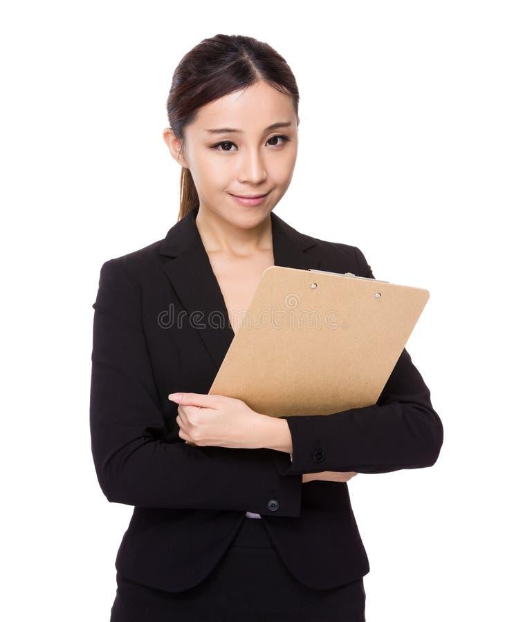 Posse nova da mulher de negócios com prancheta foto de stock royalty free
