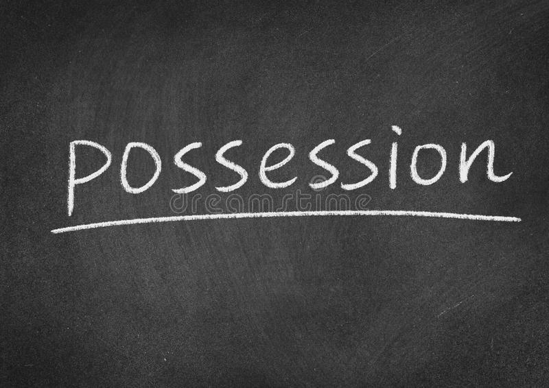 Possession. Concept word on a blackboard background stock photography