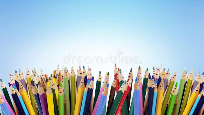 Colored pencils funny faces of people smiling. Dialogue group of people. Crowd Talking. Group of people talking. Social network stock photo
